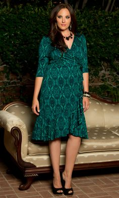 Feel the allure of our plus size Enticing Emerald Flirty Flounce Wrap Dress!  The gorgeous green hue gets balanced out perfectly with the black detailing in the print.  www.kiyonna.com  #KiyonnaPlusYou  #Plussize  #MadeintheUSA  #Green