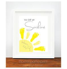 Yellow & Gray Nursery Art -You Are My Sunshine Art Print - Baby Footprint Sun - Baby Wall Art - Baby Nursery Decor. $30.00, via Etsy.
