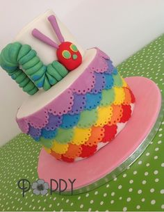 Very Hungry Caterpillar! - I love how this colorful cake turned out.  It is a champagne cake, filled with raspberry French buttercream, and covered in chocolate ganache.