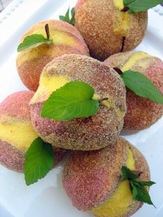 Little Peach Cakes, two small cakes with frosting filling, rolled in colored sugar. Super easy and makes beautiful, realistic peaches for a centerpiece, plus dessert for later!