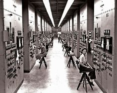 Manhattan Project: Calutron operators at their panels, in the Y-12 plant at Oak Ridge, TN during World War II.