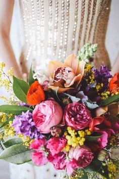 Beautiful and colorful bridal bouquet. Garden roses, stock, orchids. #bouquet  #color #gardenroses