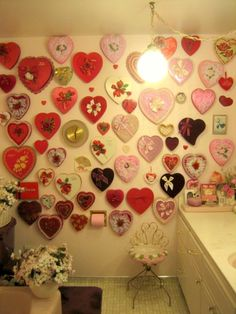 An entire bathroom wall in Valentine candy box lids.