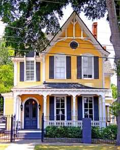 Our next cottage is yellow, so cute with blue trim