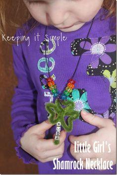 St. Patrick Day Kids Craft Idea: Little Girl Pipe Clean Shamrock Necklace #kidscraft #girls #stpatricksday #keepingitsimple