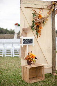Real Weddings: Ashlei & Steven in Plant City, FL | Sunflowers, barn wedding, vintage barn doors, burlap runner, arbor, #hadfundecoratingthis