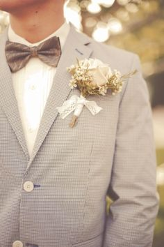 boutonniere tied with a lace ribbon // photo by Gideon Photography