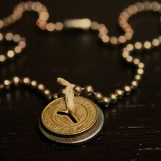 jewelry made from old subway tokens - NYC