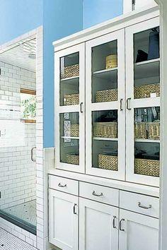 A soft blue wall sets off a mostly-white bathroom for a clean, fresh feel. | Photo: Michael Jensen | thisoldhouse.com bathroom design, blue walls, placid blue, 2014 color, cabinet, bathrooms, bathroom idea, drawer, blues