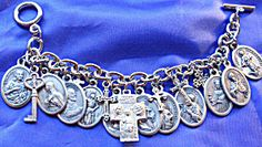 $119 This 7 inch silver tone charm bracelet is loaded with hard to find (rare) Catholic Saints Holy medals featuring the following:  Center cross with Jesus, Virgin Mary   & St. Joseph on one side and  St. Christopher on the other side.  St. Philomena  St. Monica / St. Augustine   Padre Pio  St. Joan of Arc  St. Francis of Assisi  St. Catherine of Assisi  St. Lawrence  St. Stephen  St. Barbara  St. Therese  St. John the Evangelist  Key to Heaven featuring our Lady of Grace  6 cross Charms