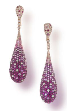 A pair of pink sapphire and diamond pendant earclips each designed as a pear-shaped bombé panel of circular-cut light and dark pink sapphires and round brilliant-cut diamonds; estimated total pink sapphire weight: 12.70 carats; estimated total diamond weight: 3.60 carats; mounted in eighteen karat rose gold; length: 3in.