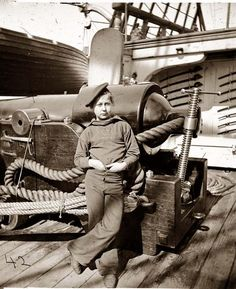 Powder Monkey by gun of U.S.S. New Hampshire off Charleston, S.C.. It was made in 1864. The photo illustrates the Federal Navy, and seaborne expeditions against the Atlantic Coast of the Confederacy -- the Federal Navy, 1861-1865.