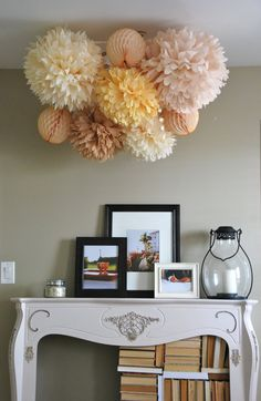 pompom bouquet for top of tent decor. Picture in soft whites with a few brightly colored fans.