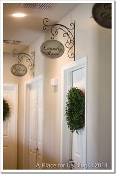 Fun way to label rooms....espeically Powder (toilet!) Room (for guests?) Hallway decorative iron signs