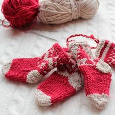 Mini knitted Christmas stockings make great tree decorations or a perfect small gift of favor during the holiday season.