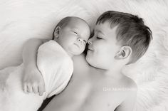 Newborn baby and older sibling (or cousins!) pose for photography session.