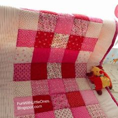 Moms, grandmas, and aunts expecting a brand new baby girl in their life will love this Pink Squares Patchwork Baby Quilt.