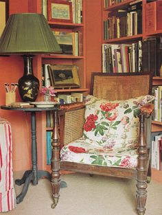 chintz cushioned chair in English library of Nicky Haslam