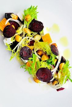 Fresh produce and high-quality meat are the cornerstones of Chef Neil Perry's menu at Sydney's Rockpool Bar and Grill, which features dishes like this colourful beetroot salad and a shortcrust beef and Guiness pie with mushy peas.