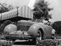 Cecil B deMille & his 1937 Packard (?)