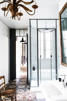 white walls, glass doors, chandelier, side chair