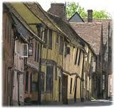 Lavenham, United Kingdom.  Its known as the Crooked Little Town.  All the buildings are insanely crooked and mis-shapen.