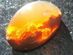 This is another kind of opal, called the Fire Opal. It's found in Mexico and inside seems to be filled with flames or a sunset.