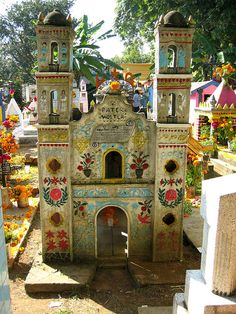 This is a pottery church used as a grave marker in a cemetery in the Yucatan