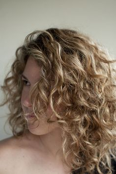 She outlines what products she uses and styling steps for her curly hair