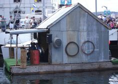 A Shanty at a Boat Show.   Which boat gets the most visitors, the fiberglass Clorox bottle boat or the tin shanty?