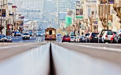 The San Francisco cable car system is the world's last manually operated cable car system which began operation in 1892 under the auspices of the San Francisco and San Mateo Electric Railway.