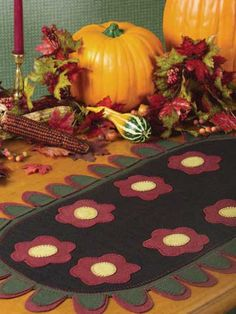 Use wool felt to make an antique-looking runner in the penny rug style.