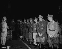 US Army translator instructs German officer POWs arriving in Boston. Germans captured by US forces, especially officers, were treated as guests rather than prisoners in the middle of a world war. The Germans fell short of reciprocating.