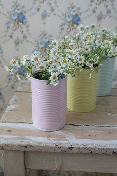 Simple, yet pretty... daisies in a spray painted can.