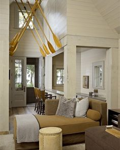 Interesting oar decor by Hickman interiors.  Browse more ideas on Completely Coastal: http://www.completely-coastal.com/search/label/Oars