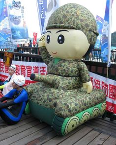 STRANGE MILITARY FUN - CHECK OUT THE CHINESE 8 FOOT TALL INFLATABLE ARMY TANK - GOOFY BLOW-UP VEHICLE!