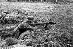 German soldier testing a British PIAT (Projector Infantry Anti-Tank) France  May 1944