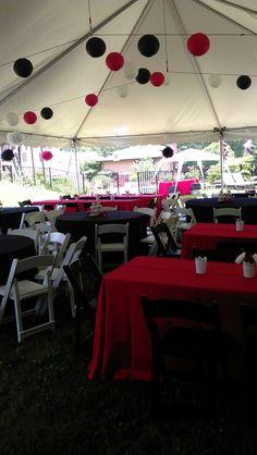 Graduation party decorations in college colors; lanterns & tissue pom-poms.