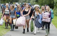 Festival style???!!! Here come the girls! But wellies will be more use than sunglasses at this festival as  washout Bank Holiday is forecast with Britain set for 50mph gales and two inches of rain in just 24 hours