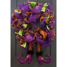 Metal Glittered Witch Broom and Witch Legs on a Deco Mesh Halloween Wreath