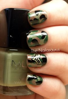 """Nail Art / In the Army...she wrote """"I used MUA Shade 23 as a base. To get the camo effect, I painted on random patches using BYS Fern, Barry M Mushroom and W7 Black. The insignia was created with black acrylic paint and Barry M Gold Foil."""""""