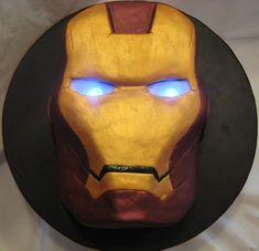 Iron Man Cake - featuring light-up eyes made from LEDs and parchment paper. If someone wants to make me a cake and it happened to be this I would love them forever lights, irons, ironman cake, cake idea, birthday parties, iron man cakes, 5th birthday, eyes, ironman birthday cake