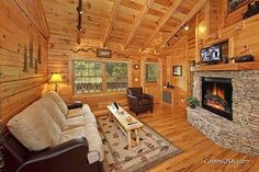 Heart to Heart cabin rental in Pigeon Forge, TN. This beautiful cabin offers a large King size bed with a heart shaped Jacuzzi tub in the master suite, and a bath with a double shower. The lovely double sided fireplace is open to the living room on one side and the bedroom on the other. Heart to Heart has all the amenities you could want-a fully equipped kitchen, full size washer and dryer, stand-up arcade game, WIFI and 2 flat screen TVs with DVD .