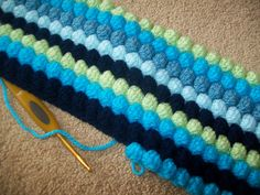 Bobble Blanket...so easy but so beautiful! and thank goodness her instructions actually make sense crochet blankets, bobbl blanket, learn how to knit, colors, bubbles, bubbl blanket, blanket patterns, yarn, learn to knit blanket