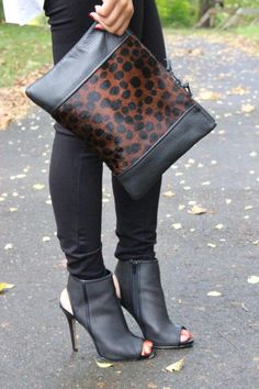 Perforated booties & a calf hair clutch.