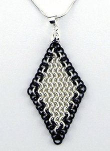 If you can't afford a real diamond, make the next best thing with this European 4-in-1 Diamond Chainmail Pendant pattern. Sleek and edgy, this pendant design edges a silver center in black jump rings for a cool two-tone look.