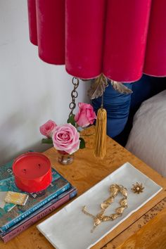 Styling   Emily Henderson 5 go-to accessories for nightstand styling     1. Lighting, obviously. You want to fill the vertical space on top of the night stand and you want convenient lighting so you aren't having to go to the wall to turn off lights. 2. A tray/bowl or box for jewelry. 3. Something that smells nice — be it a candle or flowers 4. Cute alarm clock 5. A water decanter/glass to avoid middle of the night trips to the kitchen.