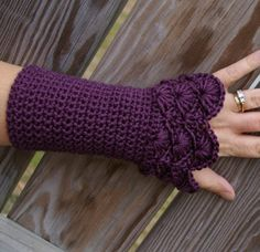 Crocheted hand warmers. Love the color, love the design.