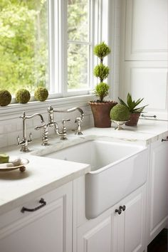 Caden Design Group: White kitchen with farmhouse sink with polished nickel vintage faucet flanked by white ...