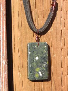 Black Flower Jade Pendant Long Leather Necklace by JewelActs, $19.00